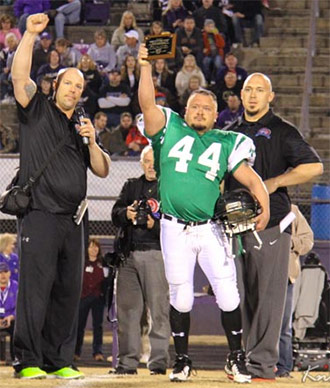 Pickens Alumni Captain Joey Edwards presenting award at the game.  Cody was sick and unable to attend.