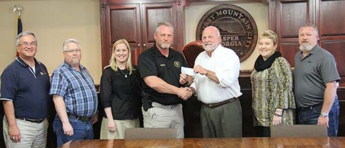 Pickens Sheriff Donnie Craig donated $5,000 to City of Jasper that will go to JYSA.