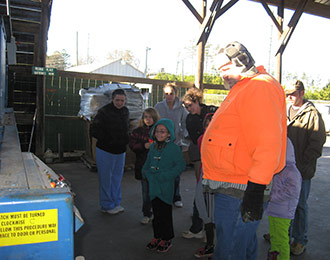 A Visit to the Camp Road Recycling Center Earns Girl Scouts Badges