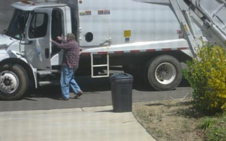 Gene Chapman working hard during City of Nelson's waste pickup
