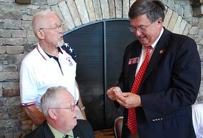 Terry Ward of the North Georgia Veterans presents to Georgia House Representative Rick Jasperse a North Georgia Veterans commemorative coin.