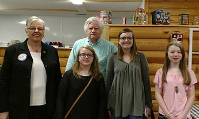 Essay winners:  In back, Susan White, Club president and Matt Moore, Project Chair with Mary Forrester, Kelsey Essig and Jasmine Miller.