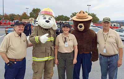 Members with Sparky and Smokey at Public Safety Day