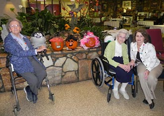 Piedmont Mountainside Hospital staff delivers decorated pumpkins to Heritage Healthcare