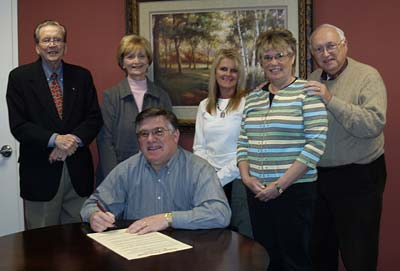 Commissioner Rob Jones signs the Proclamation for FERST Week/March 20-27, 2010