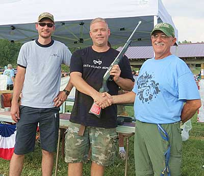 The lucky winner of the Ruger 10-22 Takedown rifle was Jared White of Locust Grove, GA (middle) being congratulated by Brannen Moss (left) of Moss Firearms and Auxiliary Unit President Gary Carson (right).