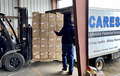 EMC staff load 550 food boxes for CARES.