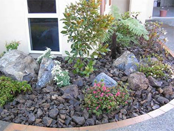 Decorative Rock Type Substrate In Flowerbeds Will Help Deter Snake Food From Living Here