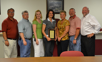 An Award of Financial Reporting Achievement presented to Tacie Williams, Director of Finance for the City of Jasper